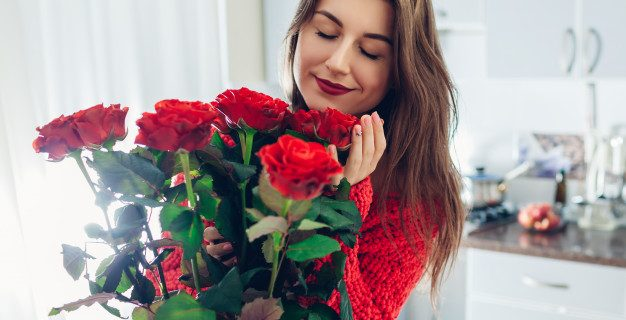 valentines day young woman found bouquet red roses kitchen happy girl holding smelling flowers 106029 1496